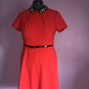 Red  dress with belt and flower decorated collar